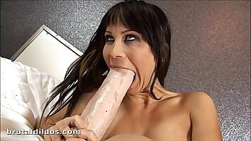 Sexually excited Slut Cristal Corina fucks her pussy with a brutal dildo