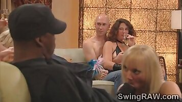 by couple of centenarians at a swingers party